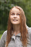 Girl enjoying rain in the park.