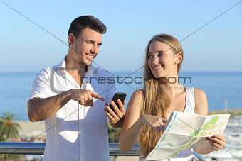 Couple discussing map or smartphone gps on vacations