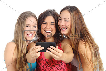 Group of three teenager girls laughing looking the smart phone
