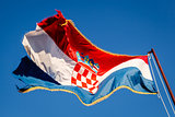 Croatian Flag Waving on a Pole over Beautiful Blue Sky in Omis,
