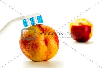 Toothbrush on fruit