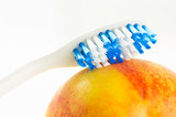 Toothbrush on fruit
