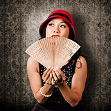Chinese girl fanning herself with Asian hand fan