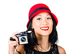 Smiling woman holding retro camera in hand