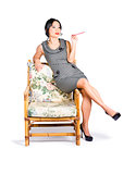 Retro woman on lounge chair with cigarette holder