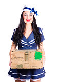 Sailor pin up holding nautical supplies