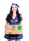 Sailor pin up holding nautical supplies