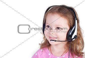 Smiling little girl in headset