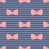 Seamless vector pattern with pastel pink bows on a navy blue strips background