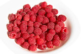 Raspberries on a plate over white