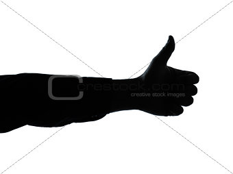 close up detail one man hand silhouette thumb up gesture