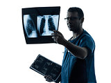 doctor surgeon radiologist examining lung torso  x-ray image