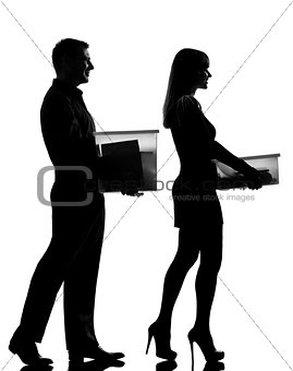 one couple man and woman walking carrying boxes happy