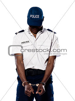 Ashamed policeman with handcuffs