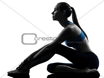 woman exercising yoga sitting stretching