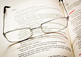 Reading glasses and dictionary