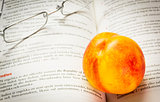 Nectarine and reading glasses