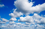 blue sky with white cumulus clouds as natural background