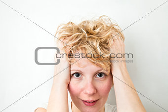 Blond Girl Pulling Hairs