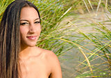 beautiful brunette in beach grass