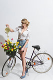 sexy woman watering with bicycle