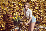 sensual blonde woman on bicycle
