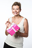 Pretty young girl opens a present
