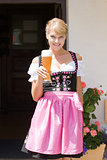 Young woman in dirndl with white beer