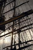 Silhouetted backlit mass of rigging