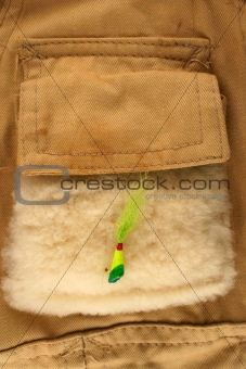 Fishing lure on a vest pocket