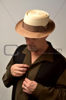 Man in Hat Going Out