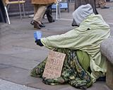 homeless man with sign