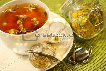 Chamomile  tea with white tea cup