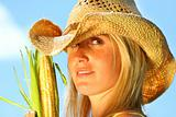 Beautiful young woman holding corn