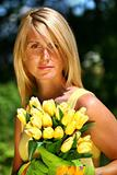 Pretty woman holding flowers