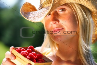 Woman showing a basket of berries