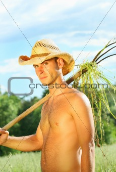 Young man working in the fields