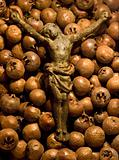 Crucifix lying on a bed of medlar fruits