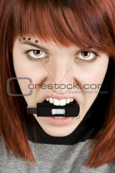 Fire-eyed girl biting memory stick