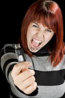 Redhead girl holding a flash drive at camera