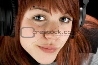 Seductive girl listening to music