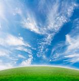 Simple beautiful blue sky and green slope.