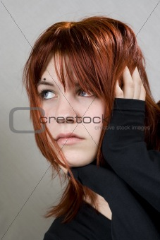 Cute redhead with messy hair looking away