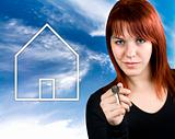 Redhead holding a house key