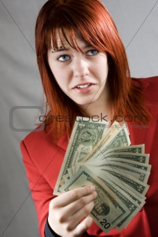 Surprised girl waving American dollars