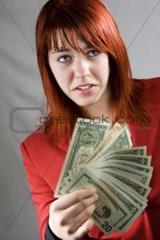 Surprised girl waving American dollars