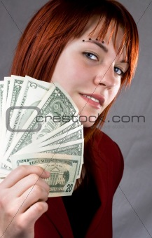 Sexy girl with a seductive look waving American dollars