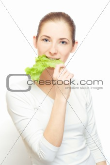 young  woman with lettuce leaf