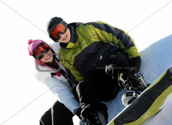 Couple of happy snowboarders