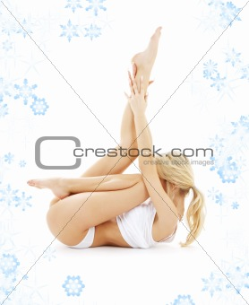 blond in white underwear practicing yoga with snowflakes